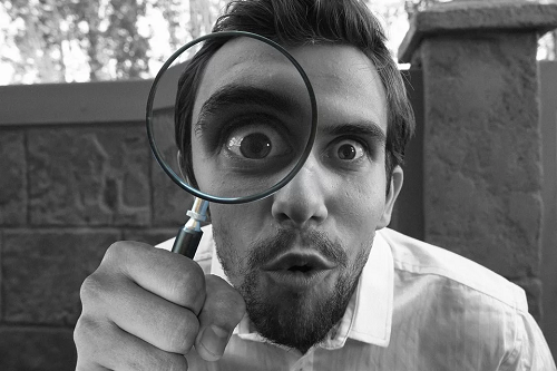 Magnifying glass in front of eye