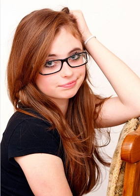 Legally Blind Requirements In The USA, Canada and The UK - Girl Wearing Glasses