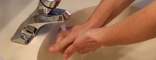 Hand washing before inserting contact lenses